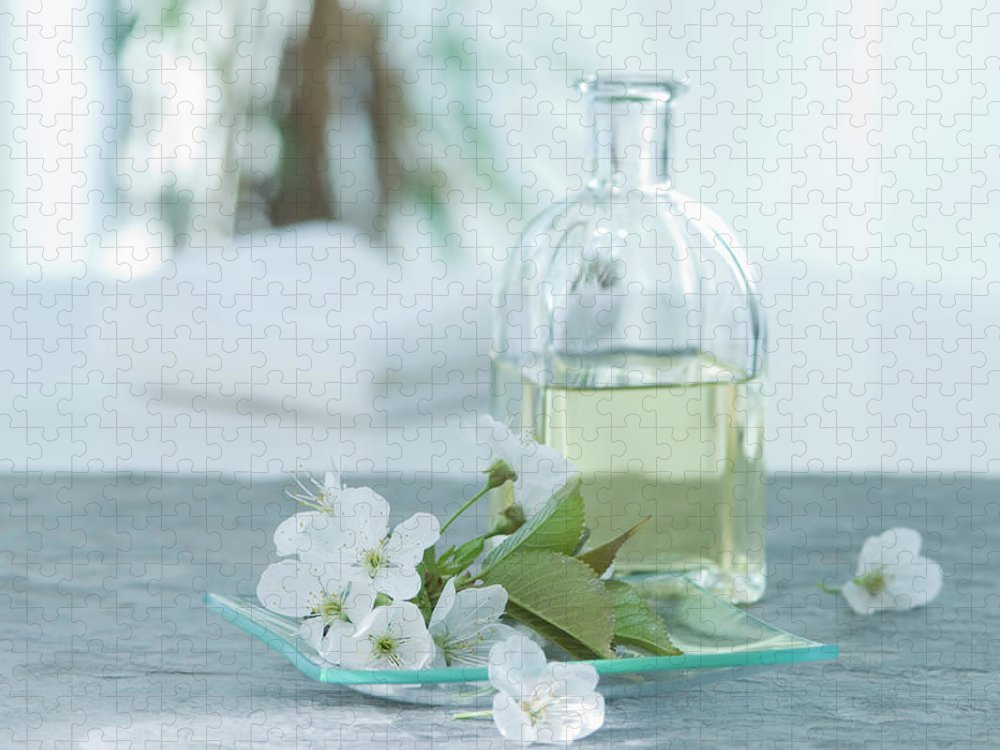 Spa Puzzle featuring the photograph Cherry Blossom With Aroma Oil, Close Up by Westend61