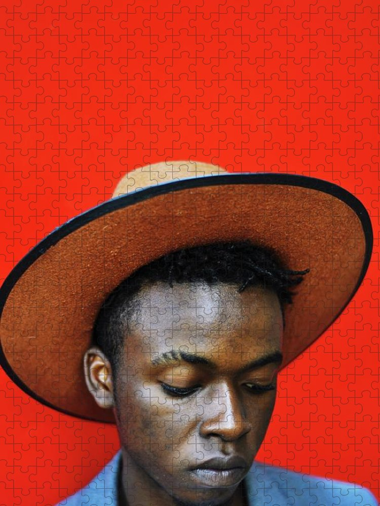 Young Men Puzzle featuring the photograph Close-up Of Man Wearing Hat Against Red by Samson Wamalwa / Eyeem