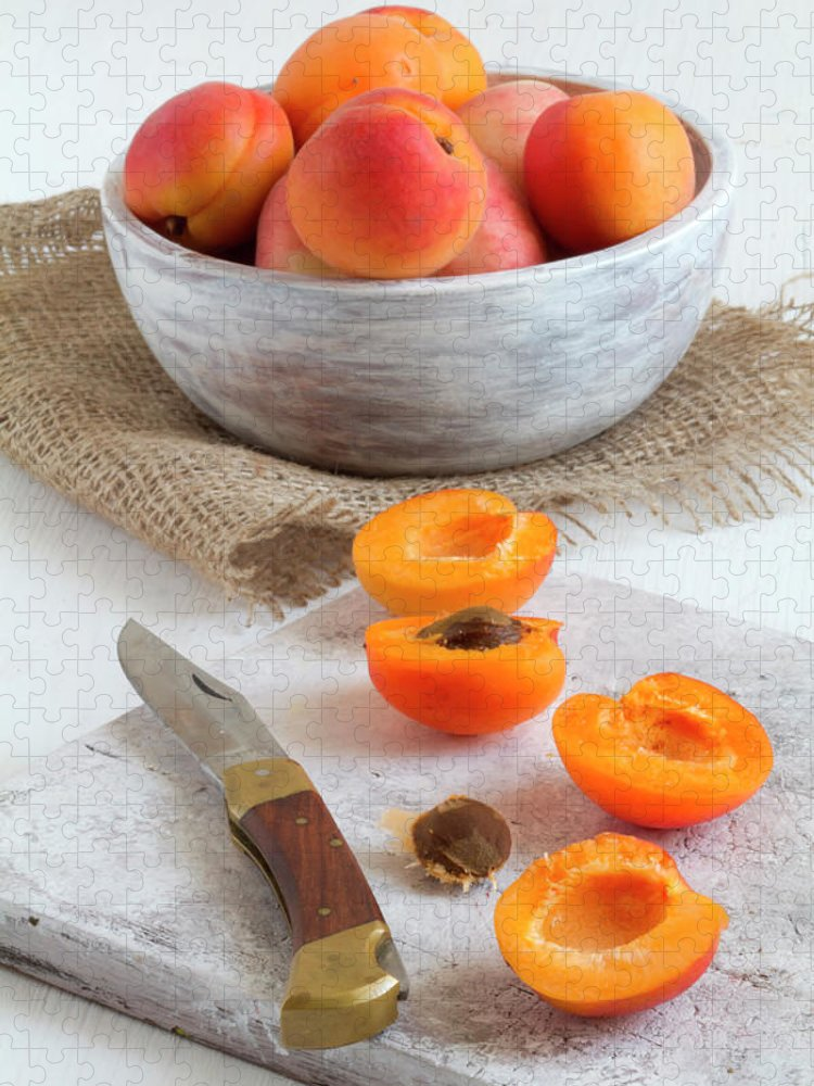 Cutting Board Puzzle featuring the photograph Cross Section Apricots With Knife And by Westend61