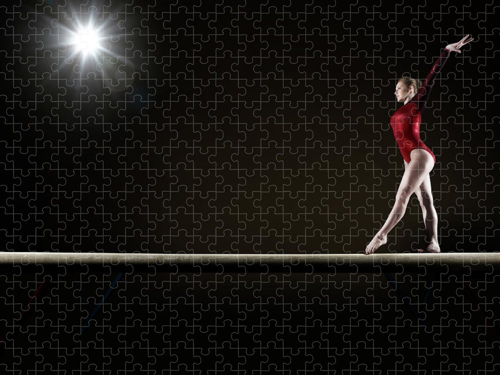 Human Arm Puzzle featuring the photograph Female Gymnast Balancing On Beam by Mike Harrington