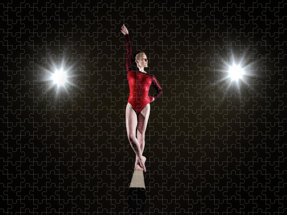 Human Arm Puzzle featuring the photograph Female Gymnast On Balancing Beam by Mike Harrington