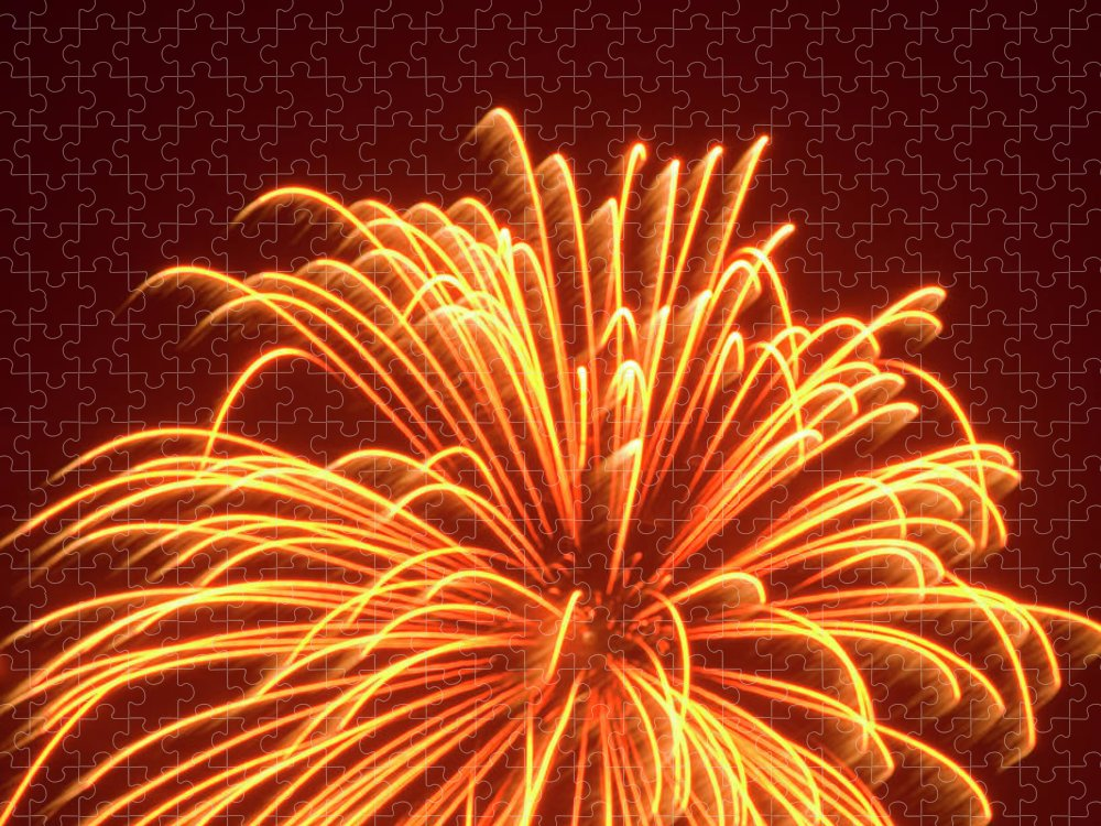 Orange Color Puzzle featuring the photograph Fireworks by Dennis Mccoleman