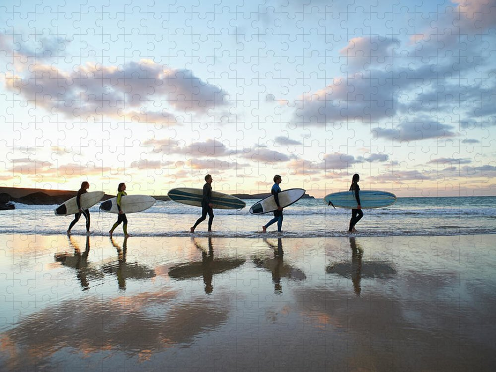 Young Men Puzzle featuring the photograph Five Surfers Walk Along Beach With Surf by Dougal Waters