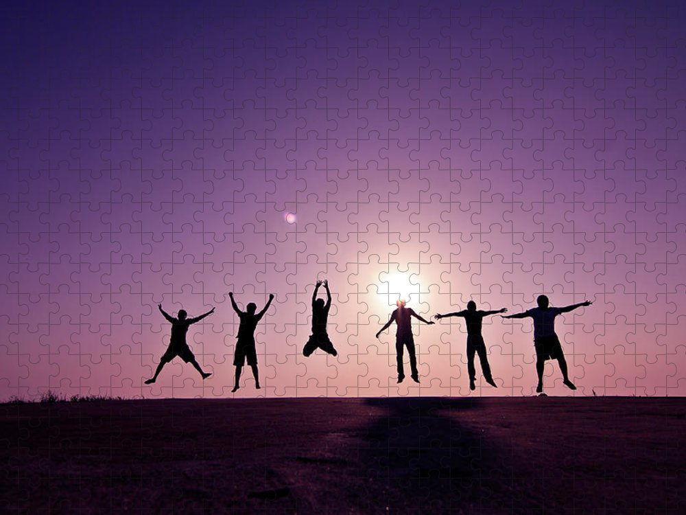 Human Arm Puzzle featuring the photograph Friends Jumping Against Sunset by Kazi Sudipto Photography