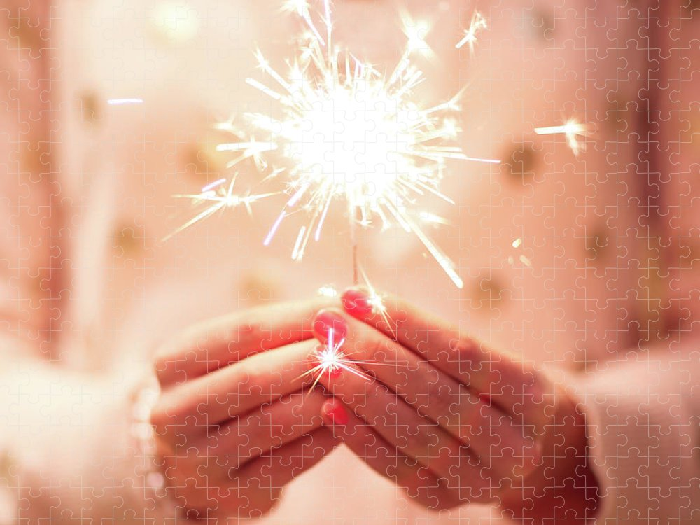 Firework Display Puzzle featuring the photograph Girl Holding Small Sparkler by Sasha Bell