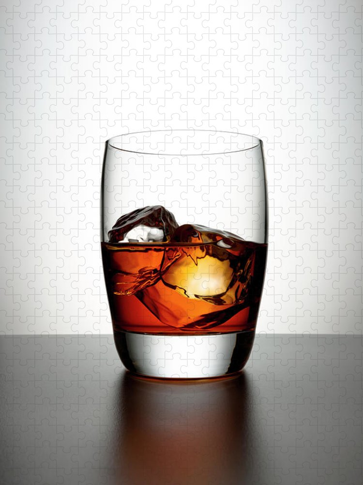 White Background Puzzle featuring the photograph Glass With Brown Liquor And Ice Cubes by Chris Stein