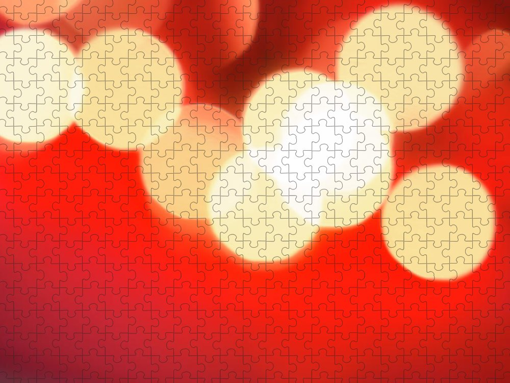 Christmas Lights Puzzle featuring the photograph Glowing Light On Red Background, Studio by Tetra Images