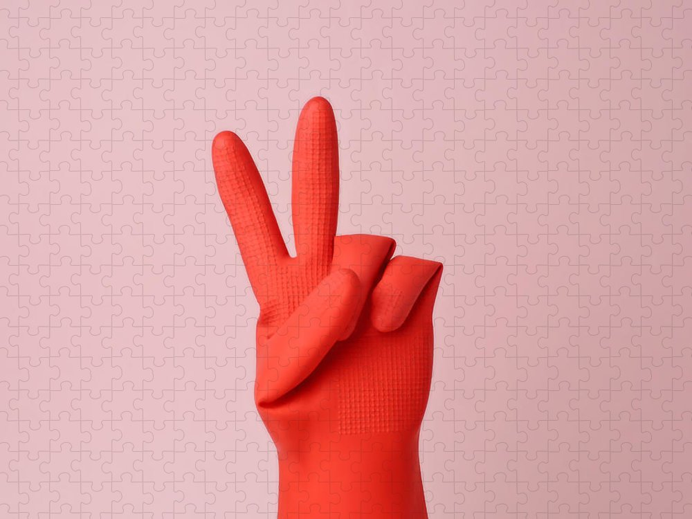Washing Up Glove Puzzle featuring the photograph Hand In Red Rubber Glove Making Peace by Juj Winn
