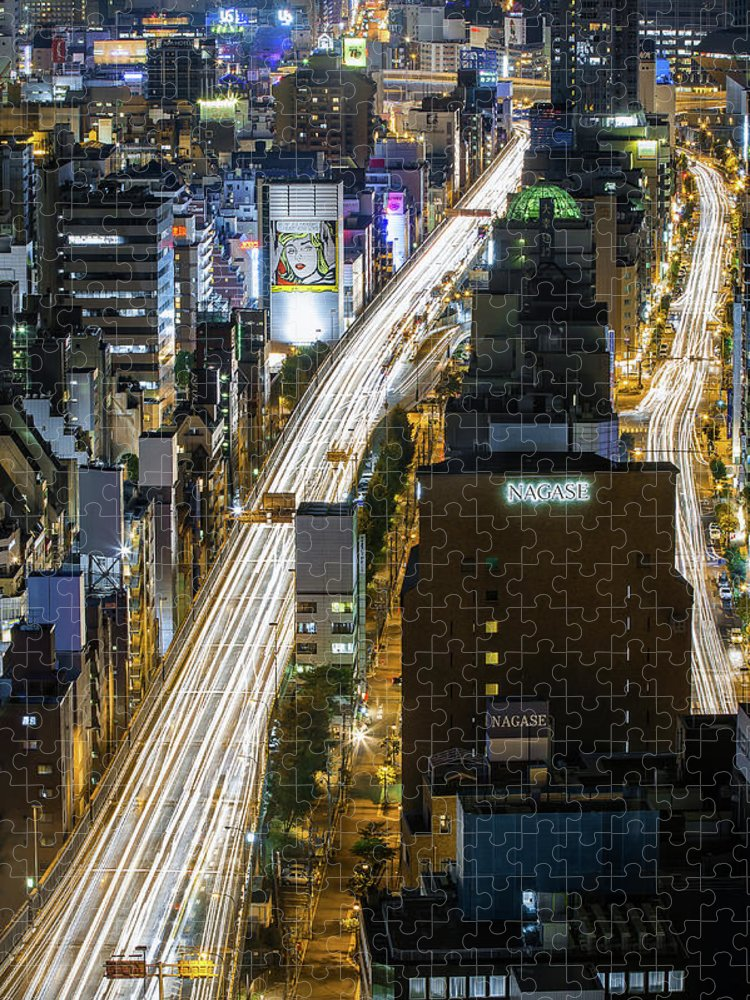 Osaka Prefecture Puzzle featuring the photograph Highway At Night In Osaka With Traffic by Sandro Bisaro