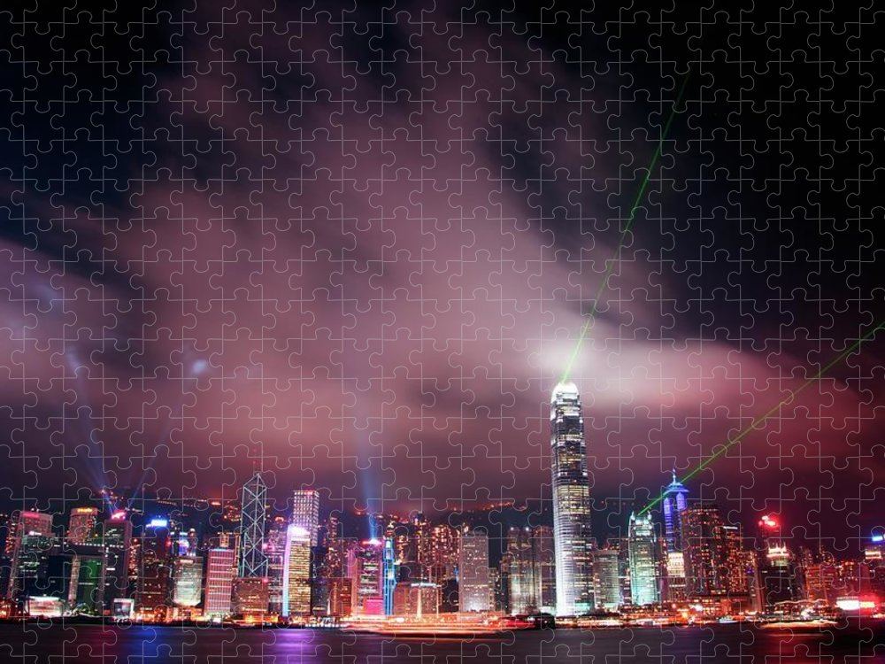 Tranquility Puzzle featuring the photograph Hong Kong Laser Lights by Photo By Dan Goldberger