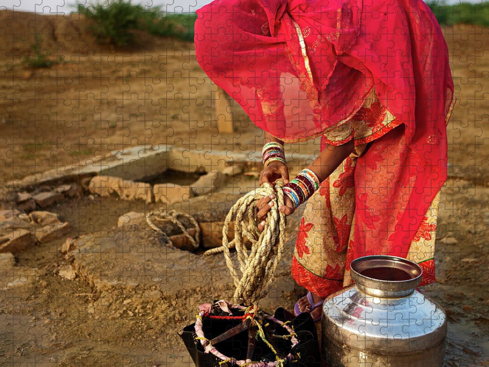 Working Puzzle featuring the photograph Indian Woman Getting Water From The by Hadynyah