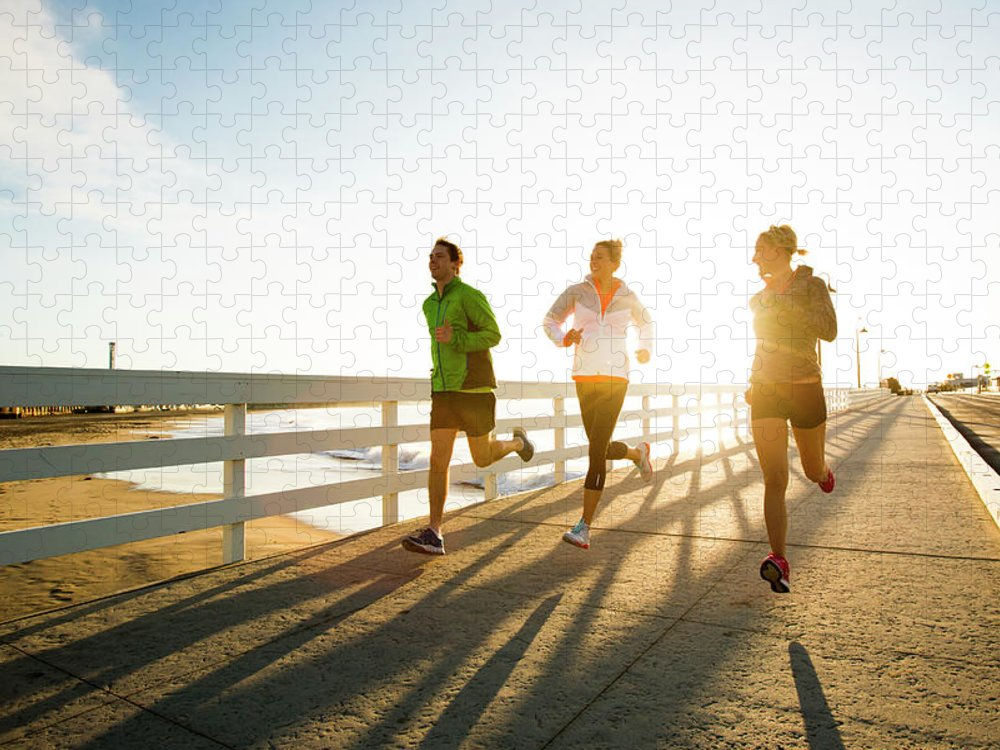 Young Men Puzzle featuring the photograph Jogging Along The Coast by Jordan Siemens