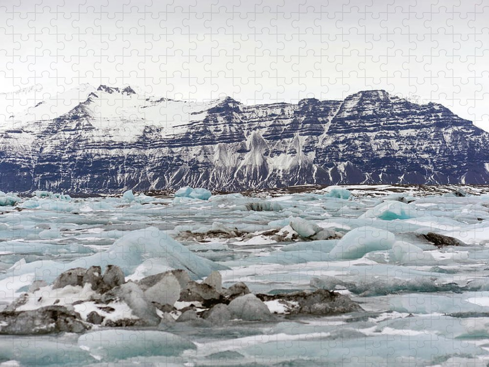 Tranquility Puzzle featuring the photograph Jokulsarlon by Photo By Dave Moore
