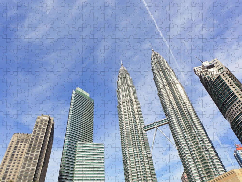 Corporate Business Puzzle featuring the photograph Kuala Lumpur Skyline by Tom Bonaventure