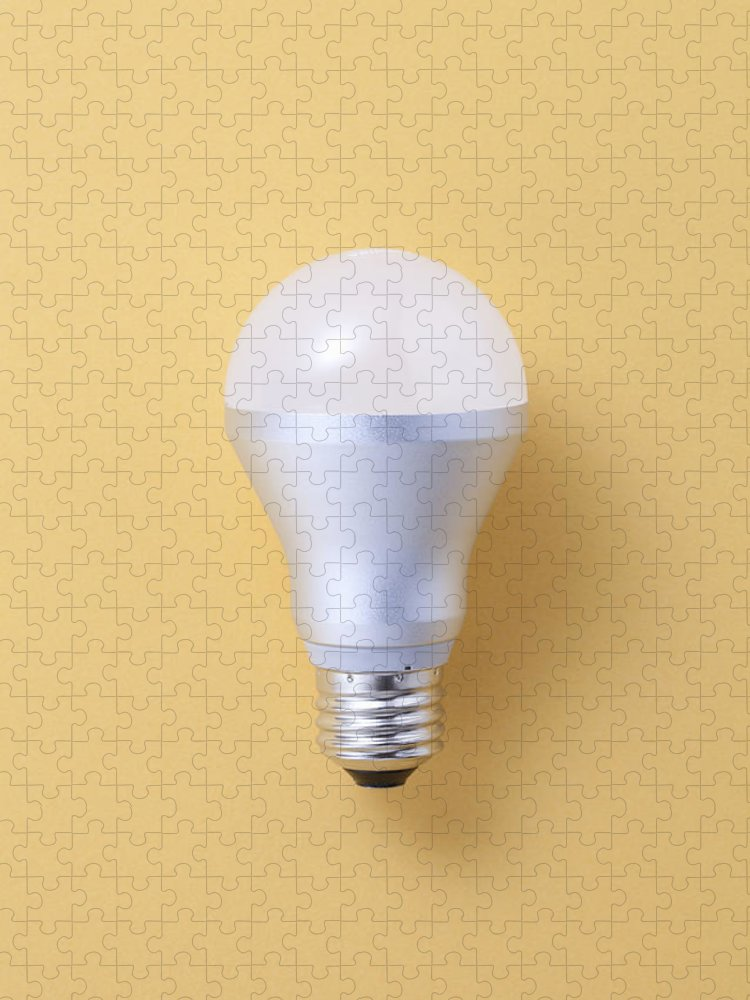 Environmental Conservation Puzzle featuring the photograph Led Bulb by Imagenavi