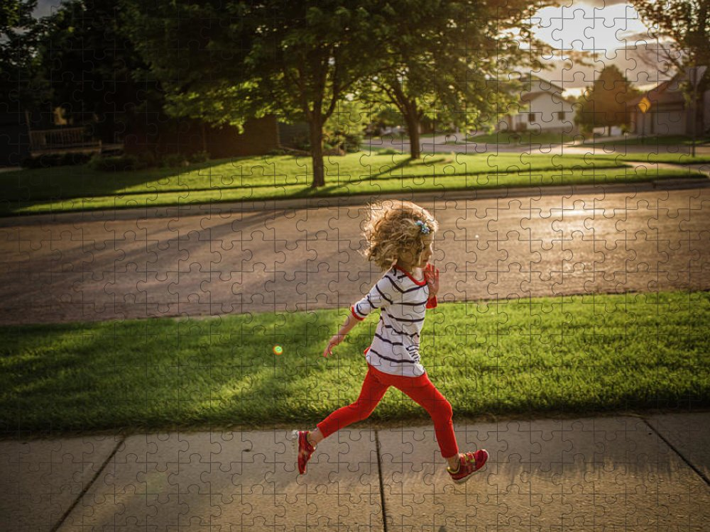 4-5 Years Puzzle featuring the photograph Little Girl Running by Annie Otzen