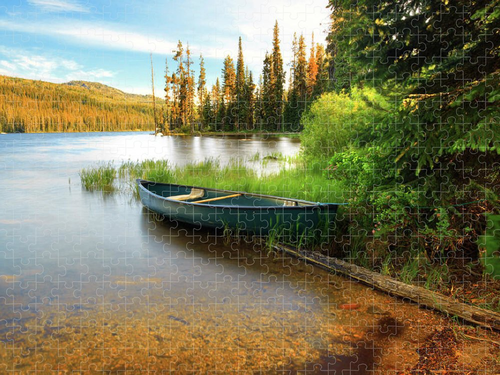 Tranquility Puzzle featuring the photograph Lone Canoe On Shores Of Upper Payette by Anna Gorin