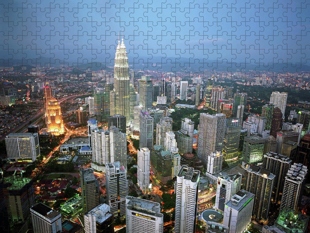 Downtown District Puzzle featuring the photograph Malaysia, Kuala Lumpur Skyline At Dusk by Martin Puddy