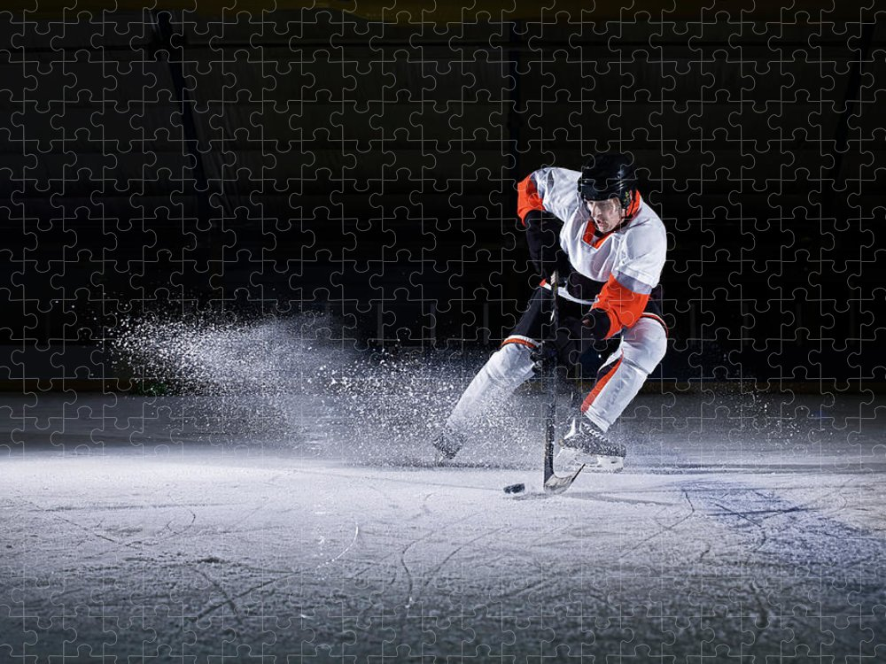 Focus Puzzle featuring the photograph Male Ice Hockey Player Taking Puck by Mike Harrington
