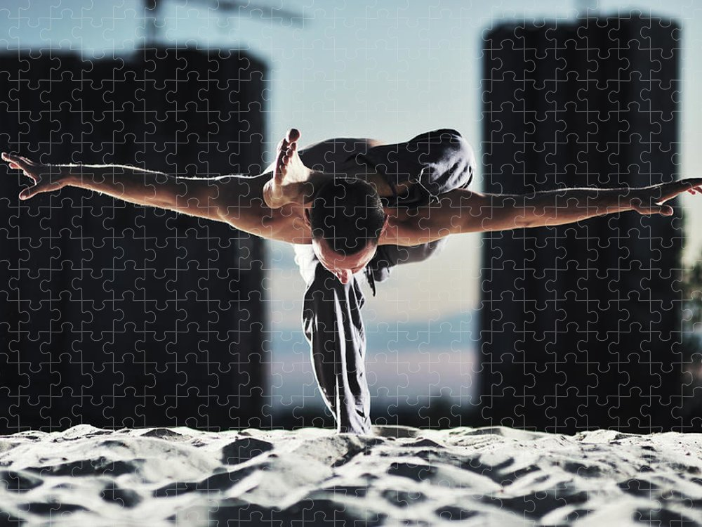 People Puzzle featuring the photograph Man Holding Yoga Pose In The Sand by Myshkovsky