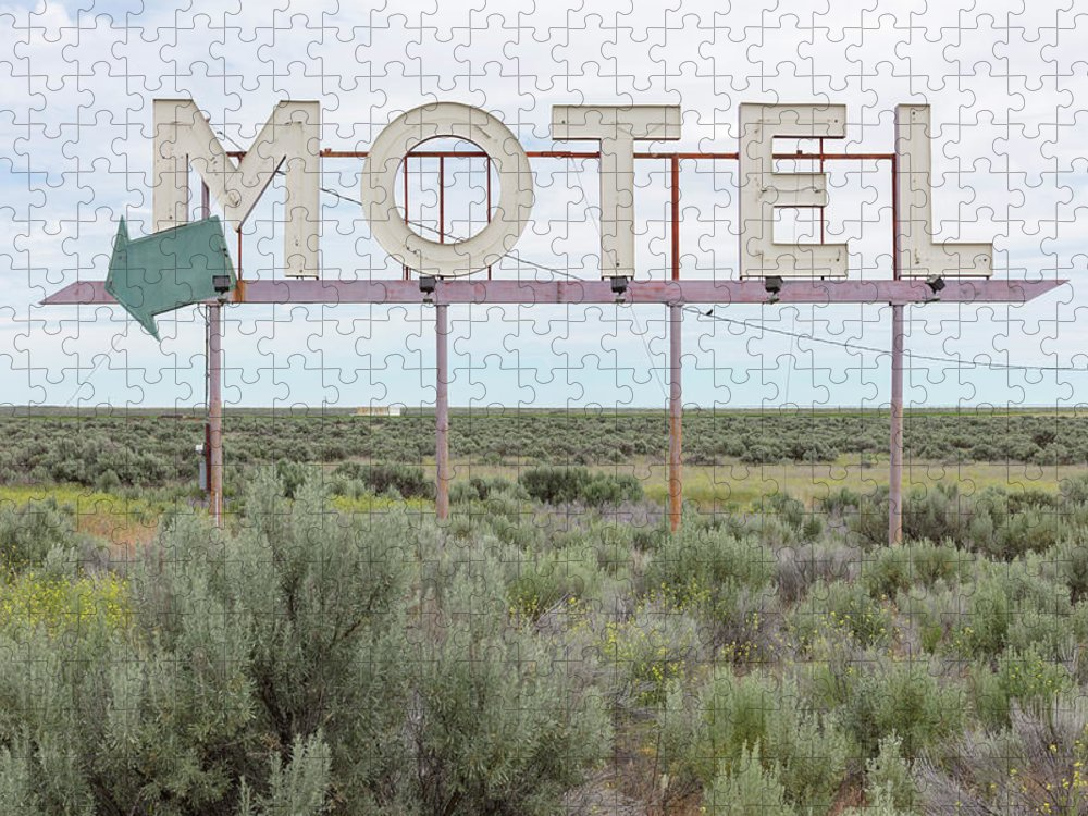 Grass Puzzle featuring the photograph Motel Sign In Field Of Sage Brush, Out by Mint Images