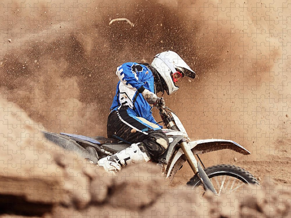 Crash Helmet Puzzle featuring the photograph Motocross Biker Taking A Turn In The by Daniel Milchev