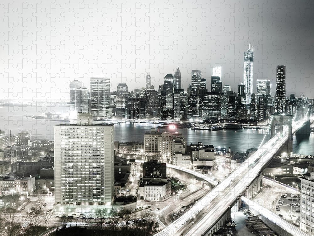 Lower Manhattan Puzzle featuring the photograph New York City Skyline At Night by Mundusimages