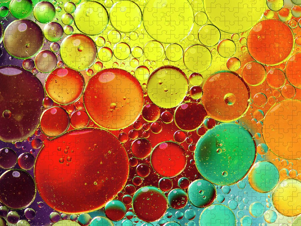 Full Frame Puzzle featuring the photograph Oil Bubbles In Water by Ramoncovelo
