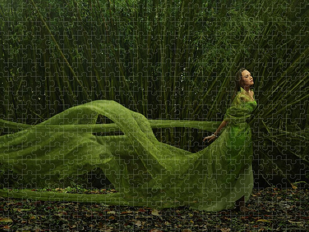 Tranquility Puzzle featuring the photograph Pacific Islander Woman In Flowing Green by Colin Anderson Productions Pty Ltd
