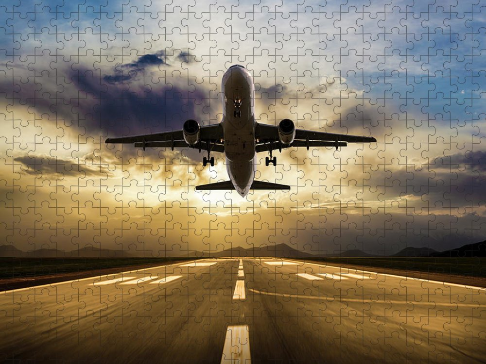 Taking Off Puzzle featuring the photograph Passenger Airplane Taking Off At Sunset by Guvendemir