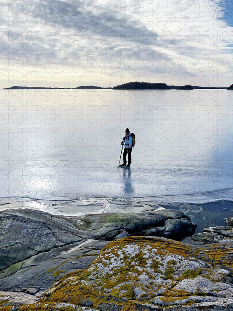 Archipelago Puzzle featuring the photograph Person Skating At Frozen Sea by Johner Images