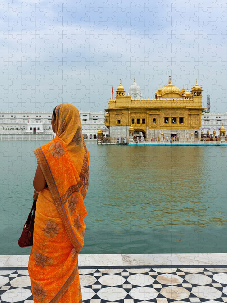 Indian Subcontinent Ethnicity Puzzle featuring the photograph Pilgrim In Golden Temple Amritsar, India by Prognone