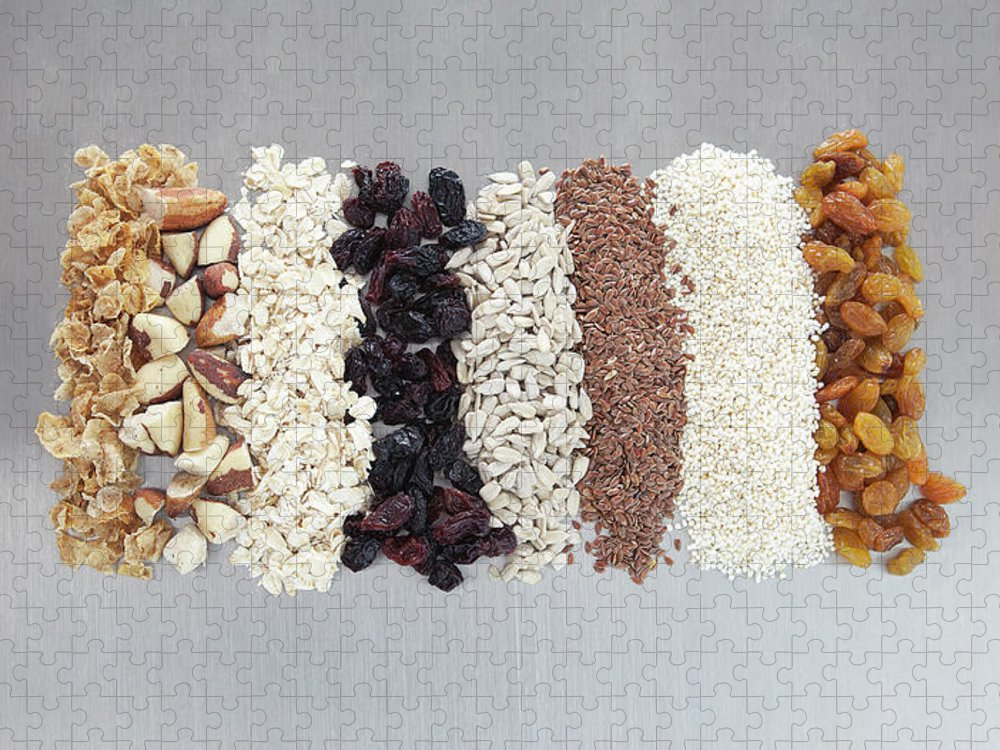 Nut Puzzle featuring the photograph Raw Nuts, Dried Fruit And Grains by Laurie Castelli