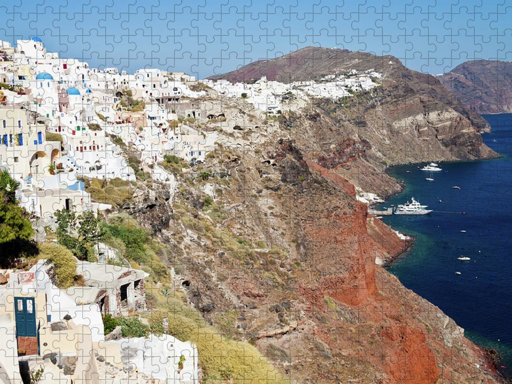 Tranquility Puzzle featuring the photograph Rows Of Houses Perch On Cliff In Oia by Melissa Tse