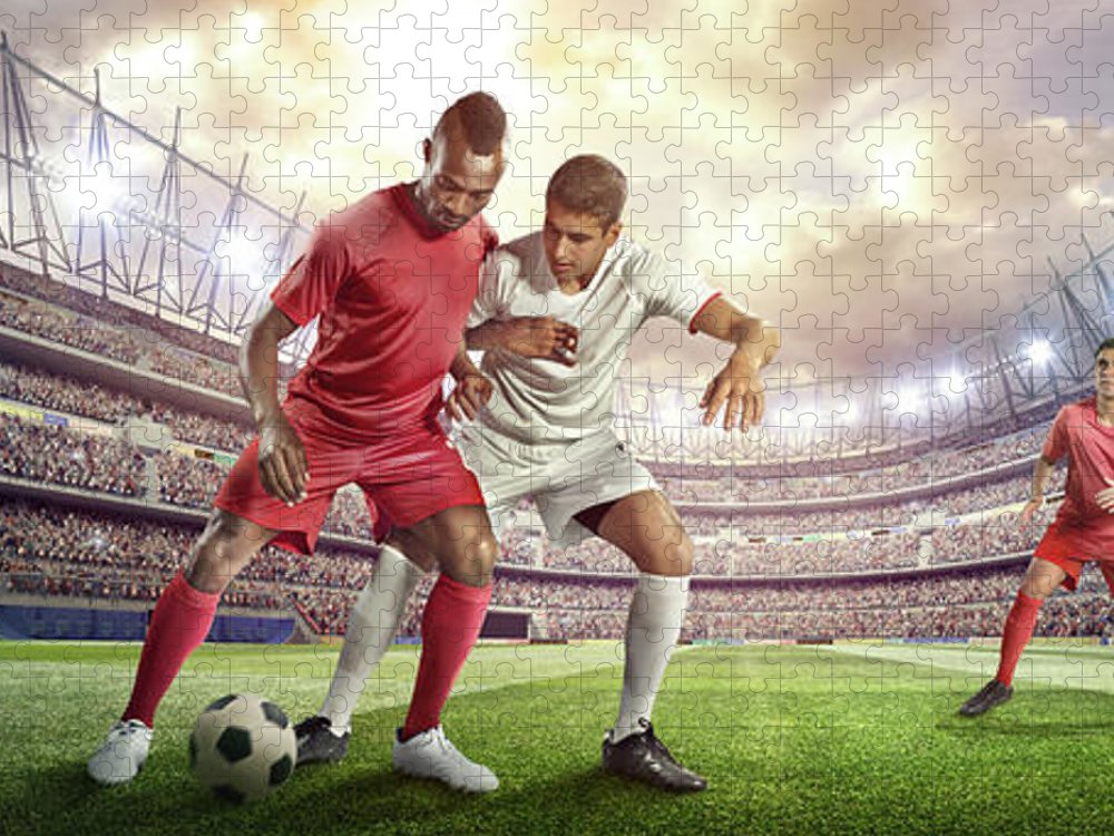 Soccer Uniform Puzzle featuring the photograph Soccer Player Tackling Ball In Stadium by Dmytro Aksonov