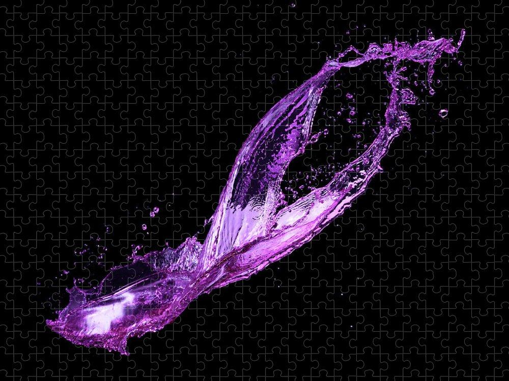 Purple Puzzle featuring the photograph Splash On Black Background by Biwa Studio