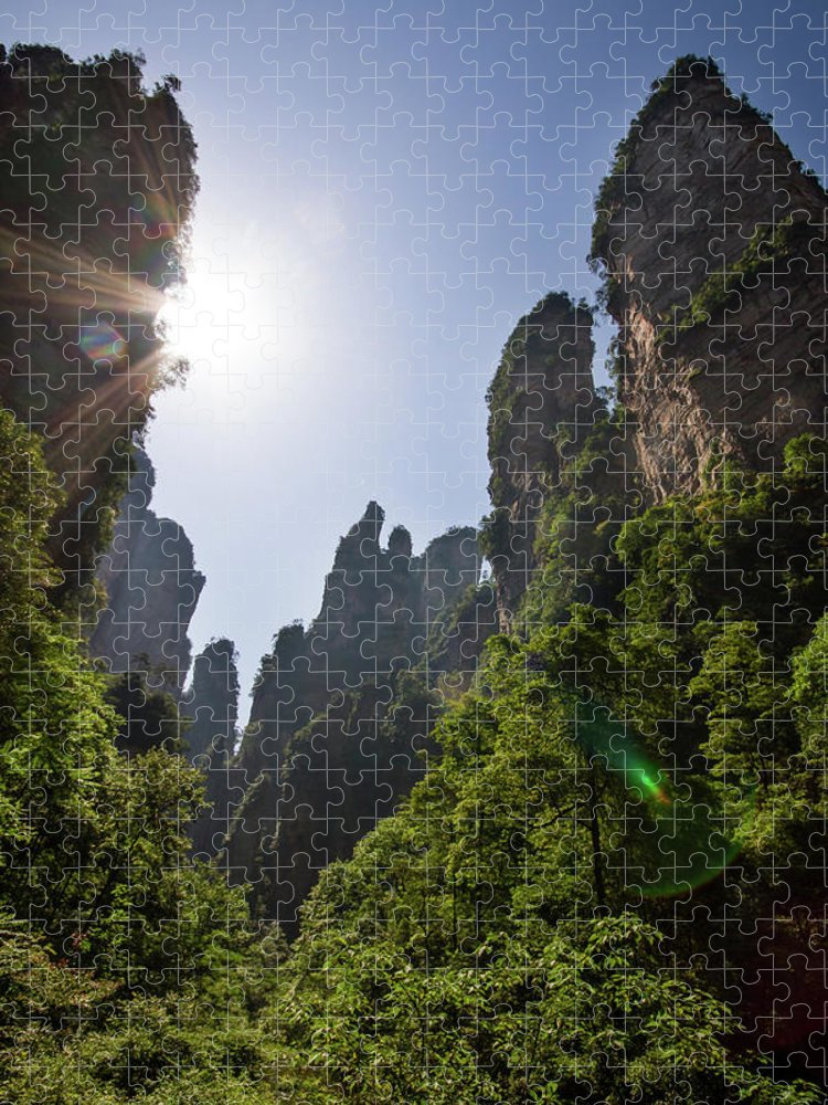 Scenics Puzzle featuring the photograph Sun Flare In Zhangjiajie Canyon by Universal Stopping Point Photography