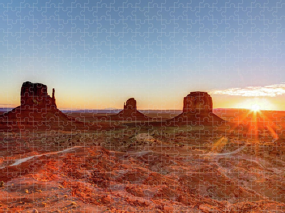 Tranquility Puzzle featuring the photograph Sunrise On Monument Valley by Loic Lagarde