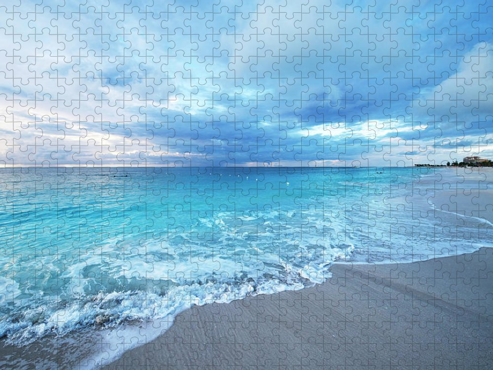 Water's Edge Puzzle featuring the photograph Sunset Over Grace Bay Of Turks & Caicos by Olga Melhiser Photography