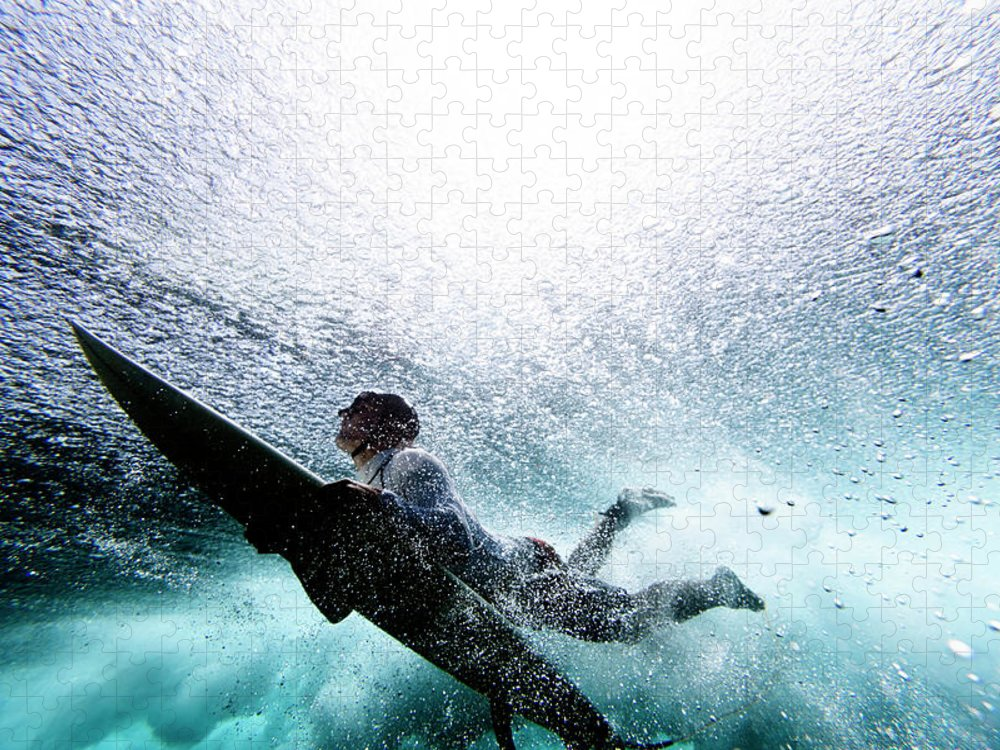Expertise Puzzle featuring the photograph Surfer Duck Diving by Subman