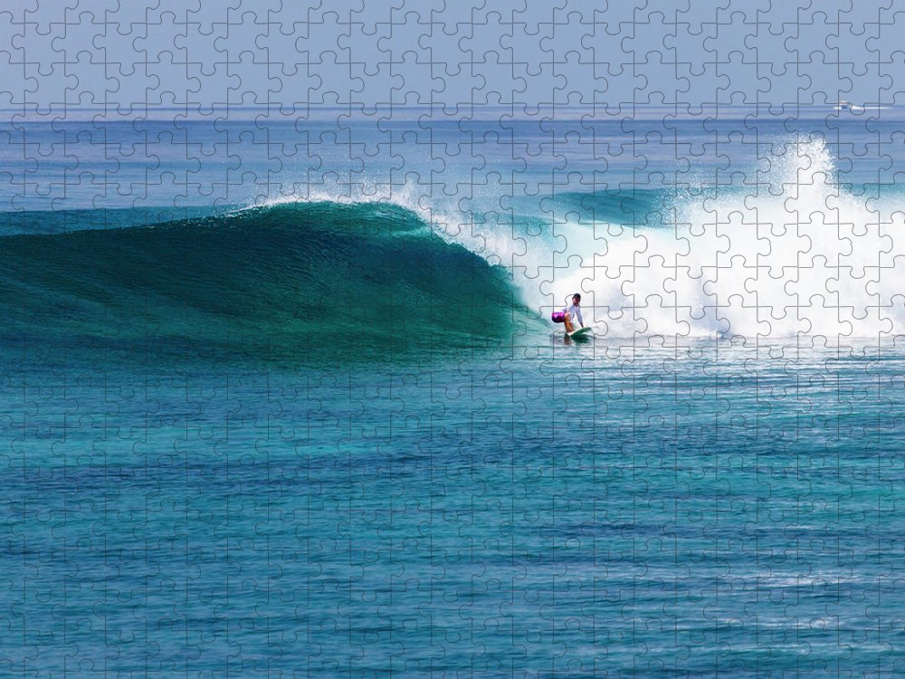Recreational Pursuit Puzzle featuring the photograph Surfer Surfing A Wave by Subman