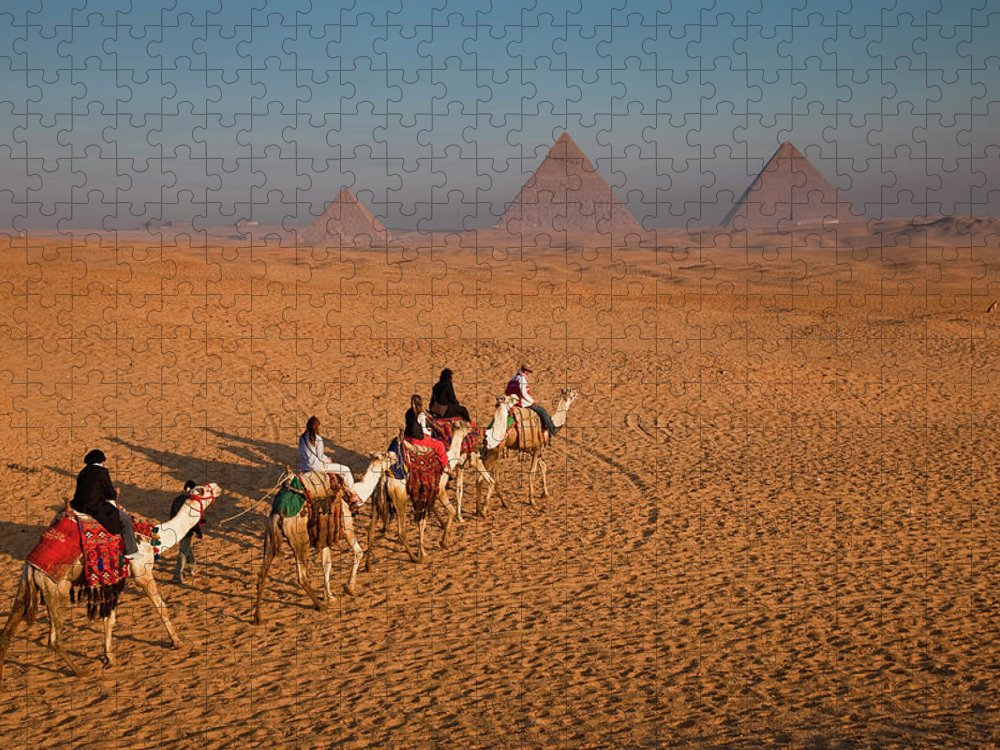 Working Animal Puzzle featuring the photograph Tourists On Camels & Pyramids Of Giza by Richard I'anson