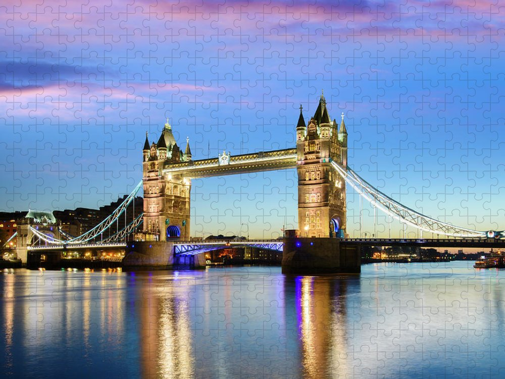 Downtown District Puzzle featuring the photograph Tower Bridge Located In London by Deejpilot