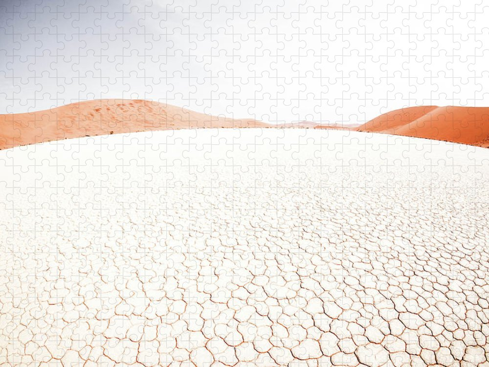 Tranquility Puzzle featuring the photograph White Clay Pan And Dunes by Taken By Chrbhm