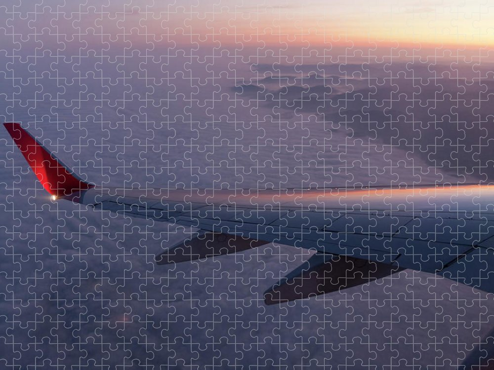 Taking Off Puzzle featuring the photograph Wing Of An Aeroplane With Sunset by Rotofrank