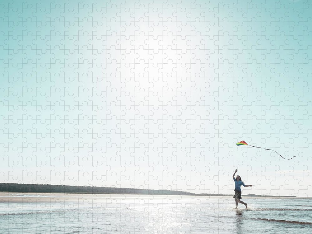 Three Quarter Length Puzzle featuring the photograph Woman Flying Kite On Beach by Dan Brownsword