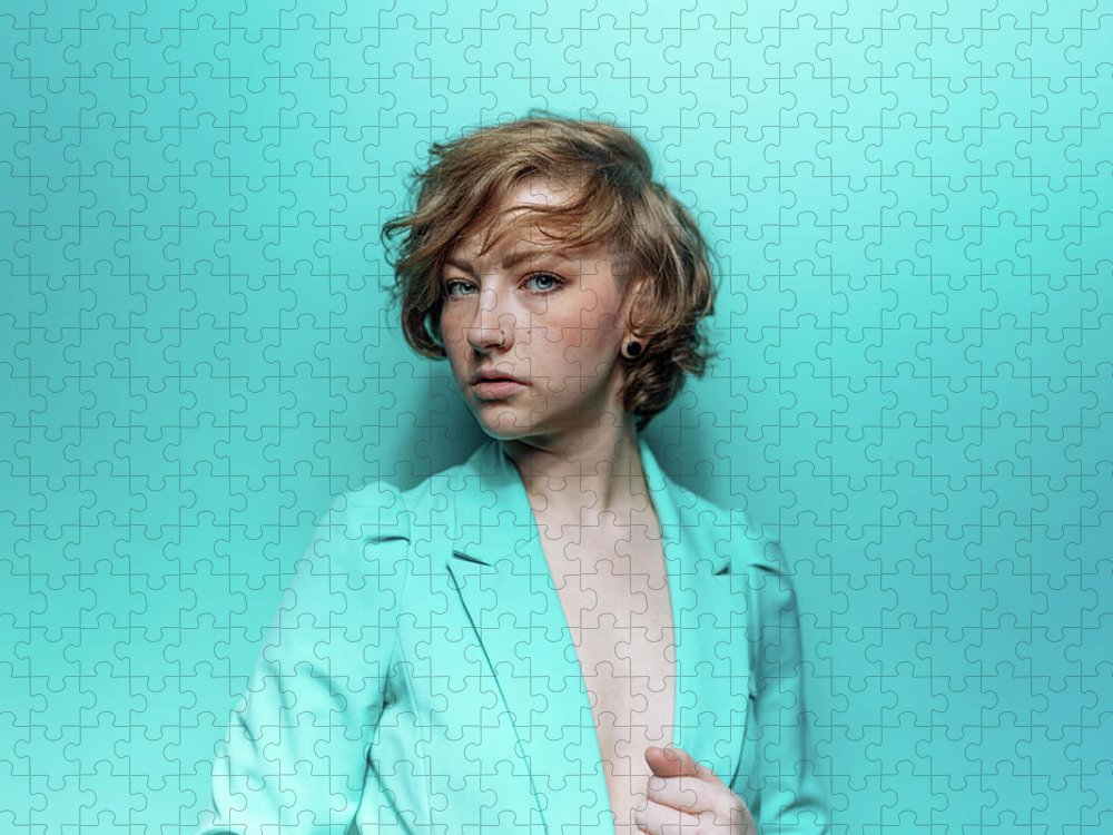 People Puzzle featuring the photograph Woman In Blue Jacket On Blue Background by Ian Ross Pettigrew