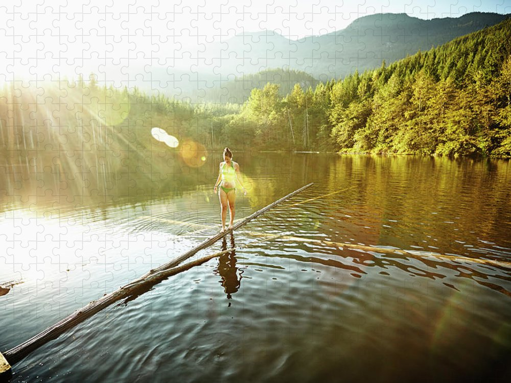 Pets Puzzle featuring the photograph Woman Walking On Log In Alpine Lake by Thomas Barwick