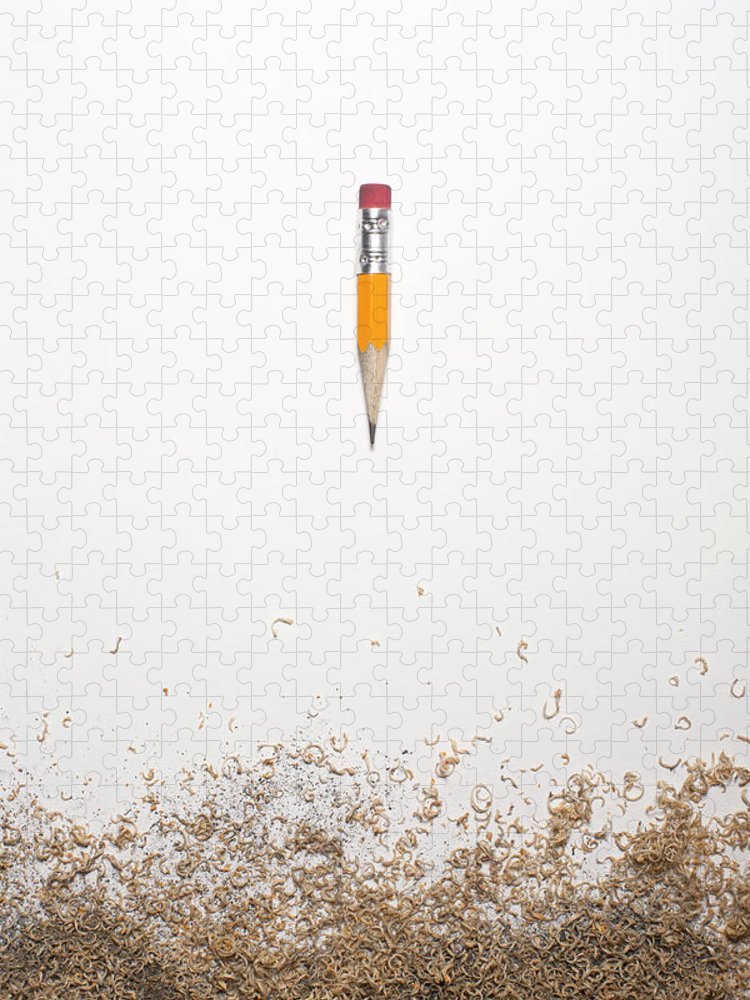 White Background Puzzle featuring the photograph Worn Down Pencil With Shaving by Chris Parsons