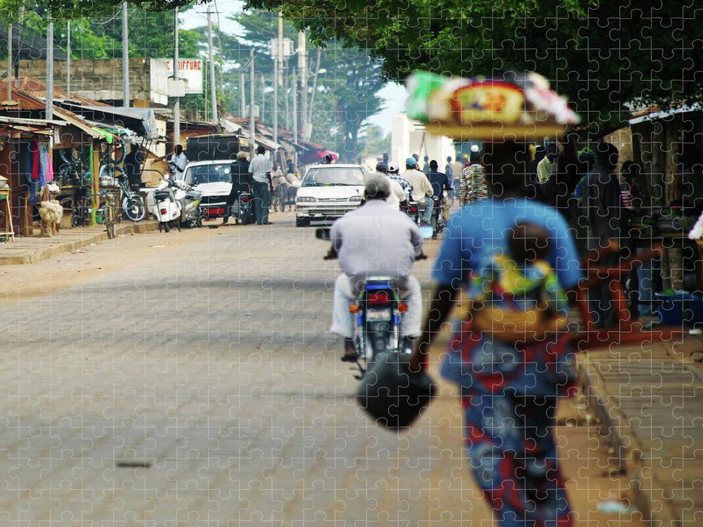Trading Puzzle featuring the photograph African Street Scene by Peeterv